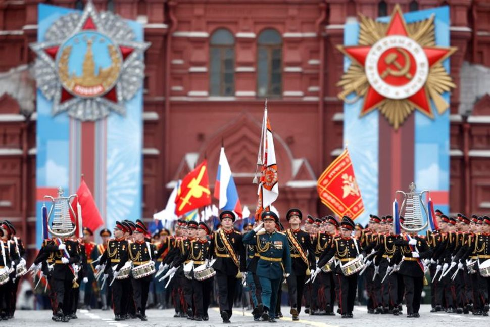 Russian service members and cadets march during a military parade on Victory Day, which marks the 76th anniversary of the victory over Nazi Germany in World War Two, in Red Square in central Moscow, Russia May 9, 2021. REUTERS/Maxim ShemetovREUTERS