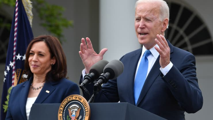 US Vice President Kamala Harris looks on as US President Joe Biden delivers remarks on Covid-19 response and the vaccination program, from the Rose Garden of the White House, Washington, DC on May 13, 2021. Nicholas Kamm | AFP | Getty Images