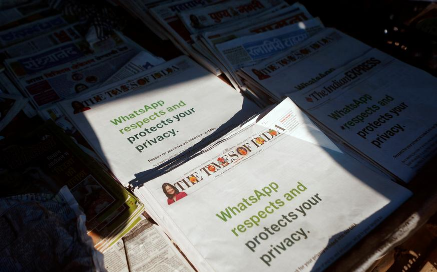 A WhatsApp advertisement is seen on the front pages of newspapers at a stall in Mumbai, India, January 13, 2021. (Photo: CNN)