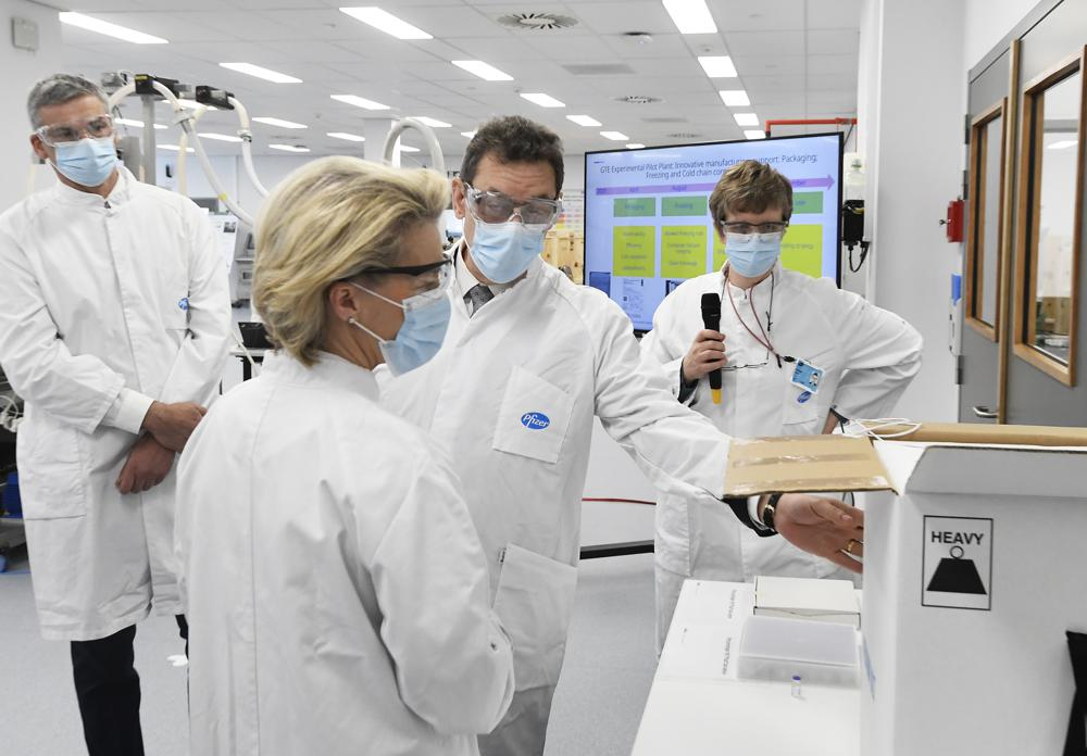 In this Friday, April 23, 2021 file photo, European Commission President Ursula von der Leyen, second left, speaks with Pfizer CEO Albert Bourla, center right, during an official visit to the Pfizer pharmaceutical company in Puurs, Belgium. The European Union cemented its support for Pfizer-BioNTech and its novel COVID-19 vaccine technology on Saturday, May 8, 2021 by agreeing to a massive contract extension for a potential 1.8 billion doses through 2023.