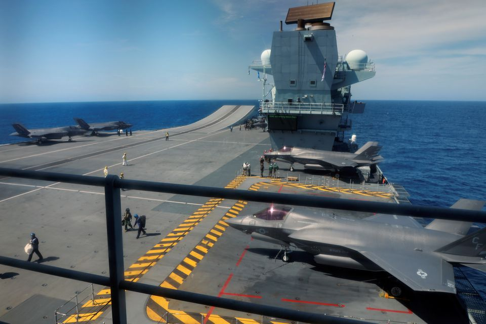 F-35B Lightning II aircrafts are seen on the deck of the HMS Queen Elizabeth aircraft carrier offshore Portugal, May 27, 2021. Picture taken through the window. REUTERS/Bart Biesemans