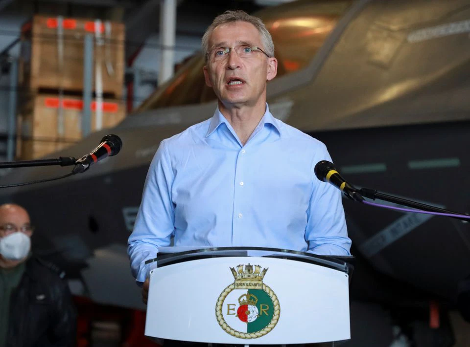NATO Secretary General Jens Stoltenberg speaks on board the HMS Queen Elizabeth aircraft carrier offshore Portugal, May 27, 2021. REUTERS/Bart Biesemans