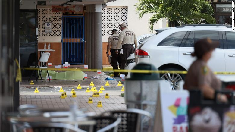 Miami-Dade police investigate Sunday near shell case markers on the ground. (Photo: CNN)