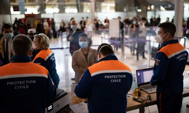 Passengers arriving at Roissy Charles de Gaulle airport near Paris in April. From Tuesday, a system will be ready to allow member states to issue a digital Covid passport to citizens proving their status and freeing them up to travel. Photograph: Ian Langsdon/AFP/Getty Images