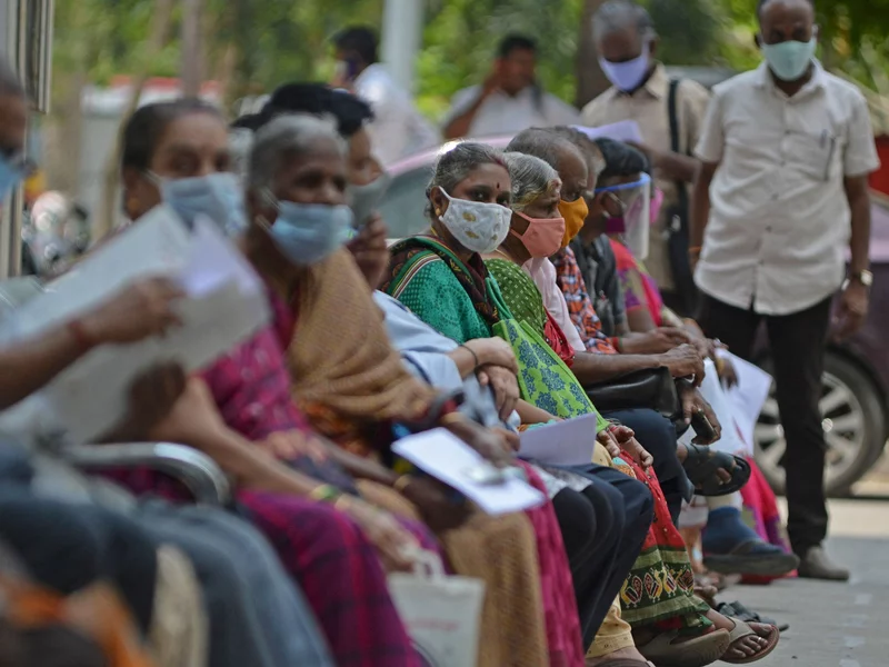 People wait their turn to receive the COVID-19 vaccine at a hospital in Chennai, India, in April. India is among the nations that will receive surplus U.S. vaccine through the international distribution system COVAX, the White House announced. Arun Sankar/AFP via Getty Images