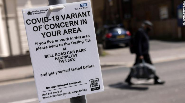 A sign directing people to vaccination center in west London. Photo: CNN