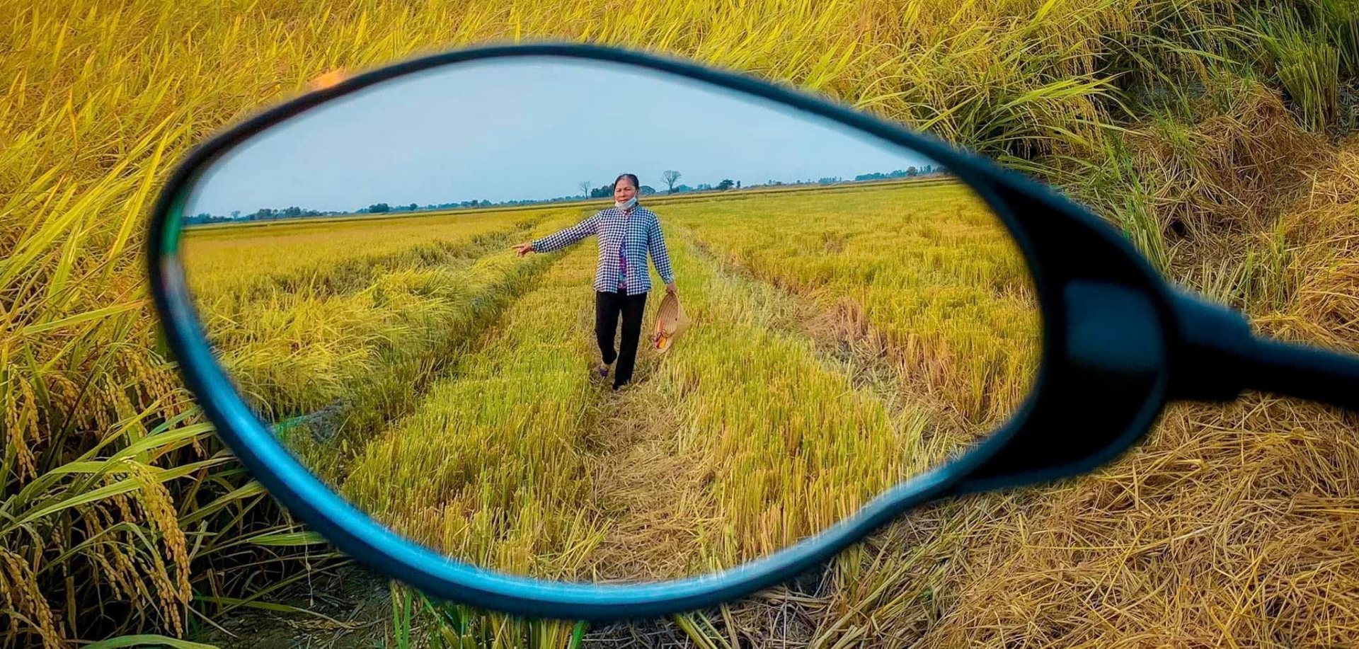 Young man captures his hometown through rear-view mirror