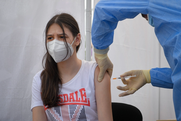 The Pfizer-BioNTech vaccine has already been approved for adolescents in the EU [Andreea Alexandru/AP Photo]