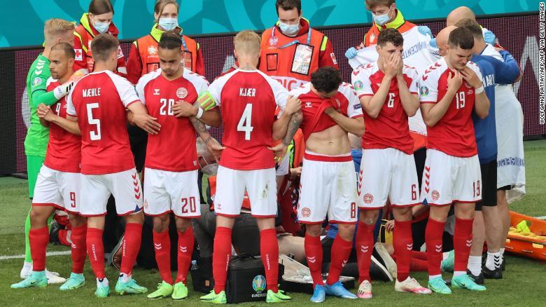 Denmark's players gather as paramedics attend to midfielder Christian Eriksen (not seen) during Saturday's match. Photo: CNN
