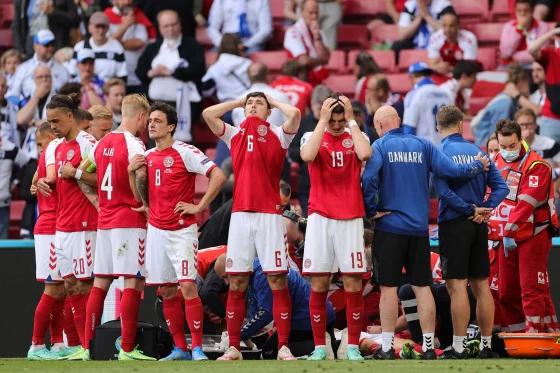 Denmark's players react as paramedics attend to Denmark's midfielder Christian Eriksen on Saturday. Friedemann Vogel / AFP - Getty Images