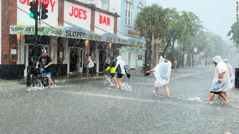 Determined visitors head to Sloppy Joe's bar while crossing a flooded Duval Street in Key West. Photo: CNN