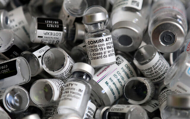 Empty vials of the Pfizer-BioNTech COVID-19 vaccine lie in a box during a vaccine campaign at the Vaccine Village in Ebersberg near Munich, Germany, May 15, 2021. (AP Photo/Matthias Schrader)