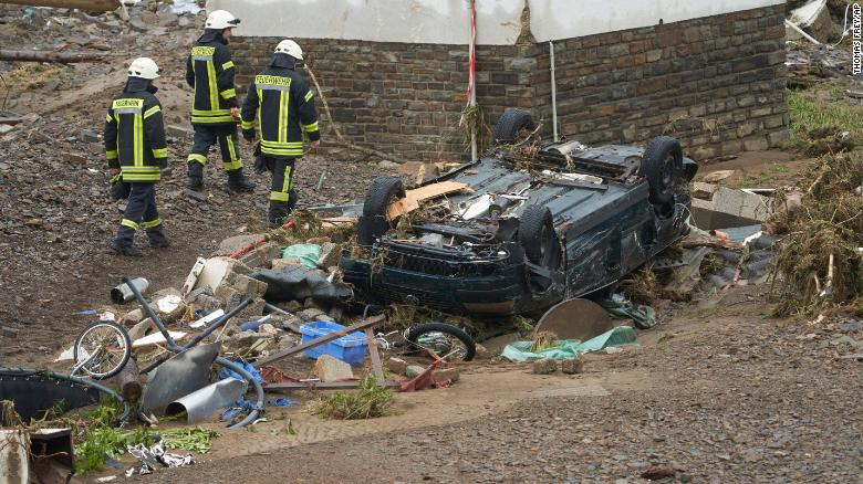 Deadly flooding in western Europe Firefighters walk past a car that was damaged by flooding in Schuld, Germany. Photo: CNN
