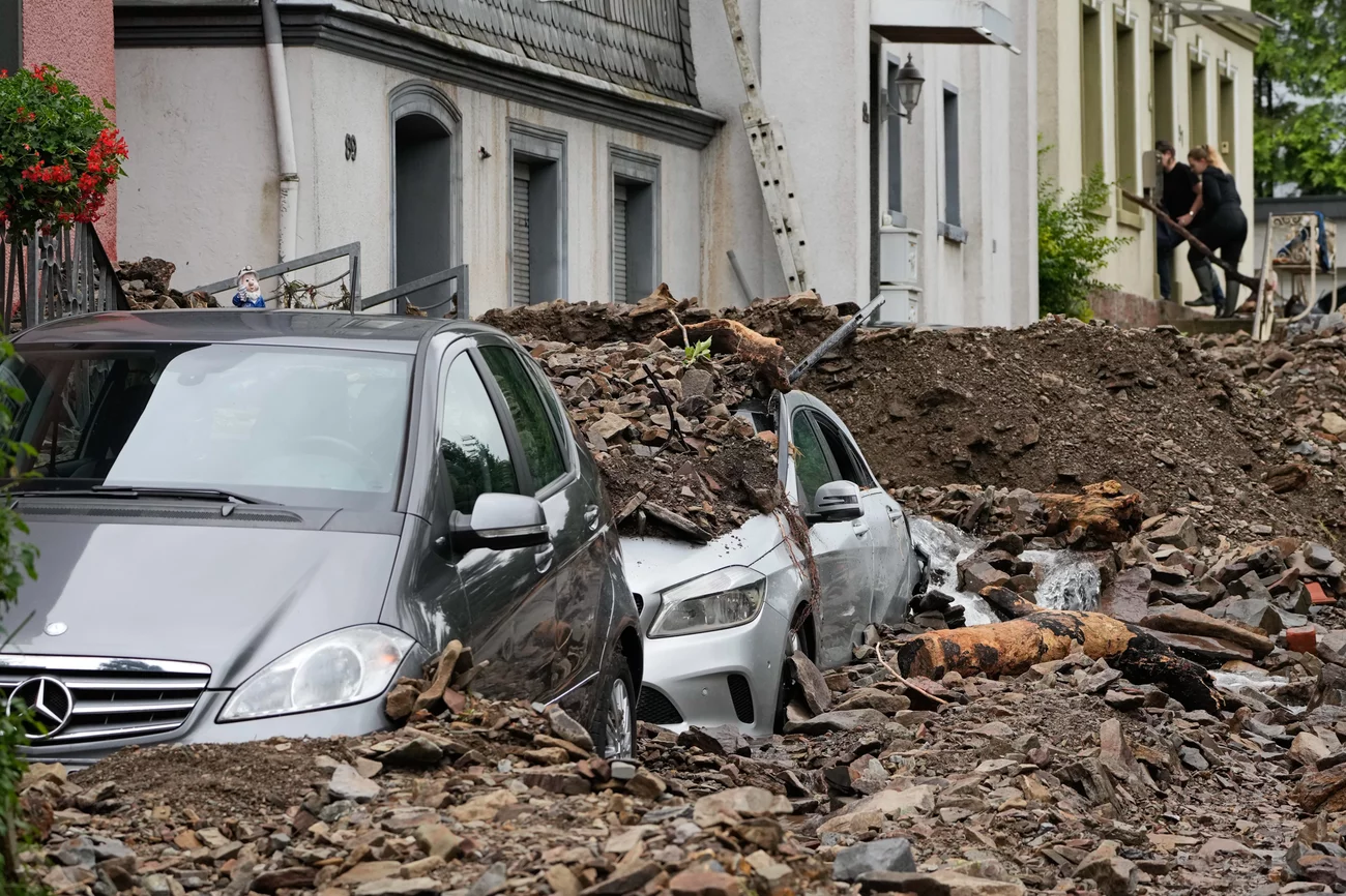 Cars are covered with debris brought on by flooding from a nearby river on Thursday in Hagen, Germany. Martin Meissner/AP