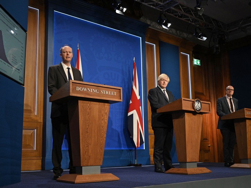 Chris Whitty, chief medical adviser to the UK government, in a 12 July press conference with Prime Minister Boris Johnson (centre) and chief scientific adviser Patrick Vallance (right).Credit: Daniel Leal-Olivas/AFP/Getty