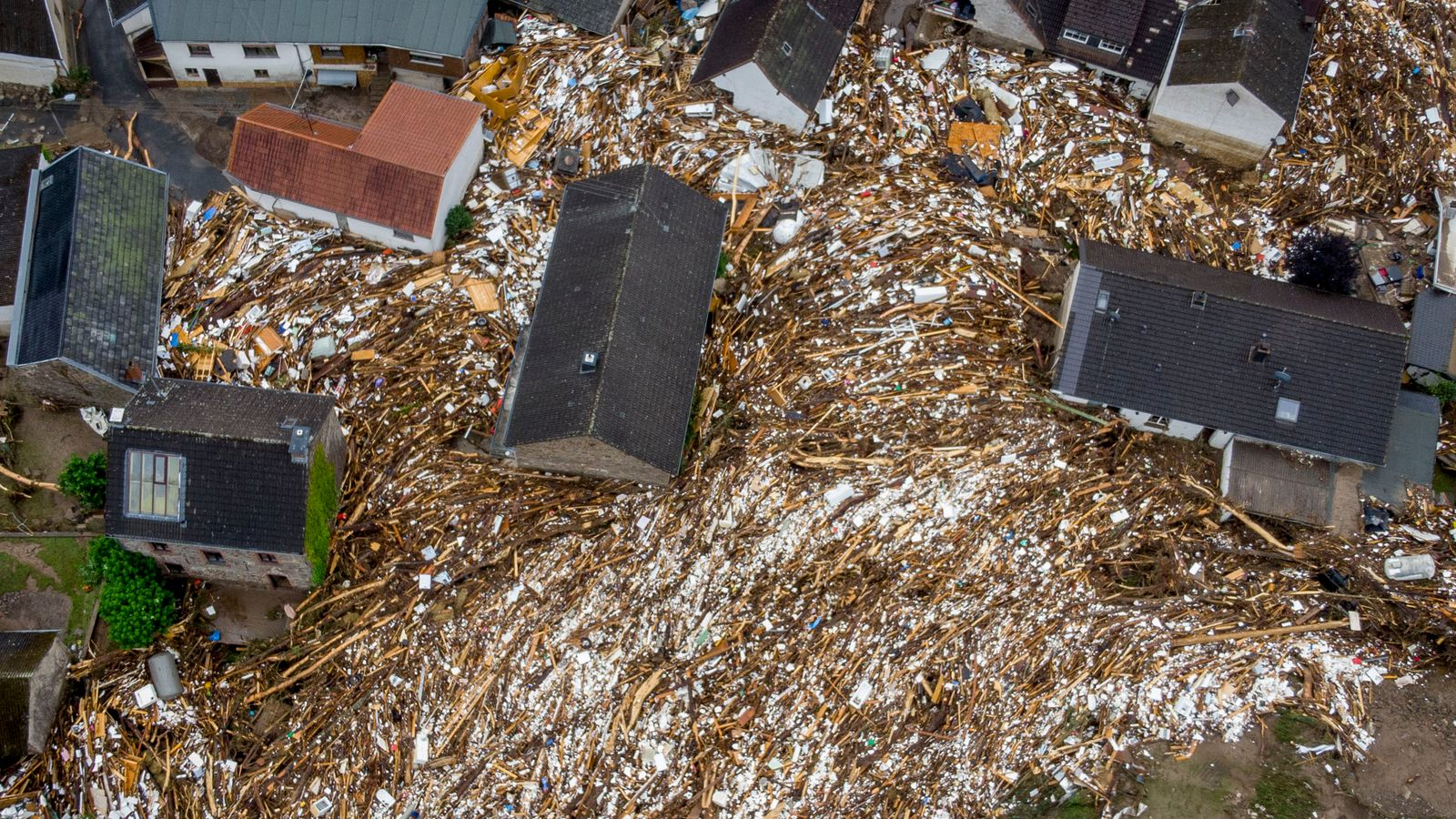 Trees and other detritus were left between houses in Schuld, Germany. Pic: Associated Press