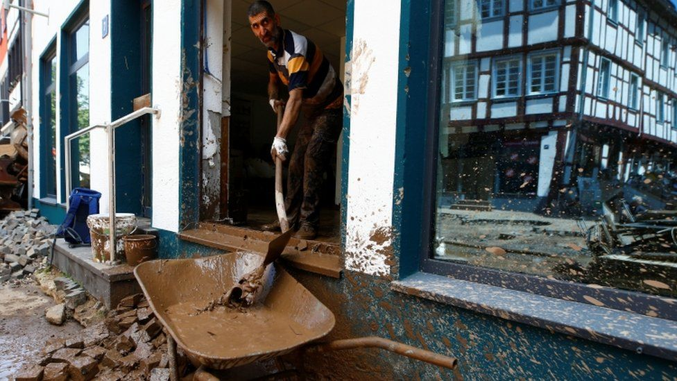 Residents are getting on with the clean-up. Photo: Reuters