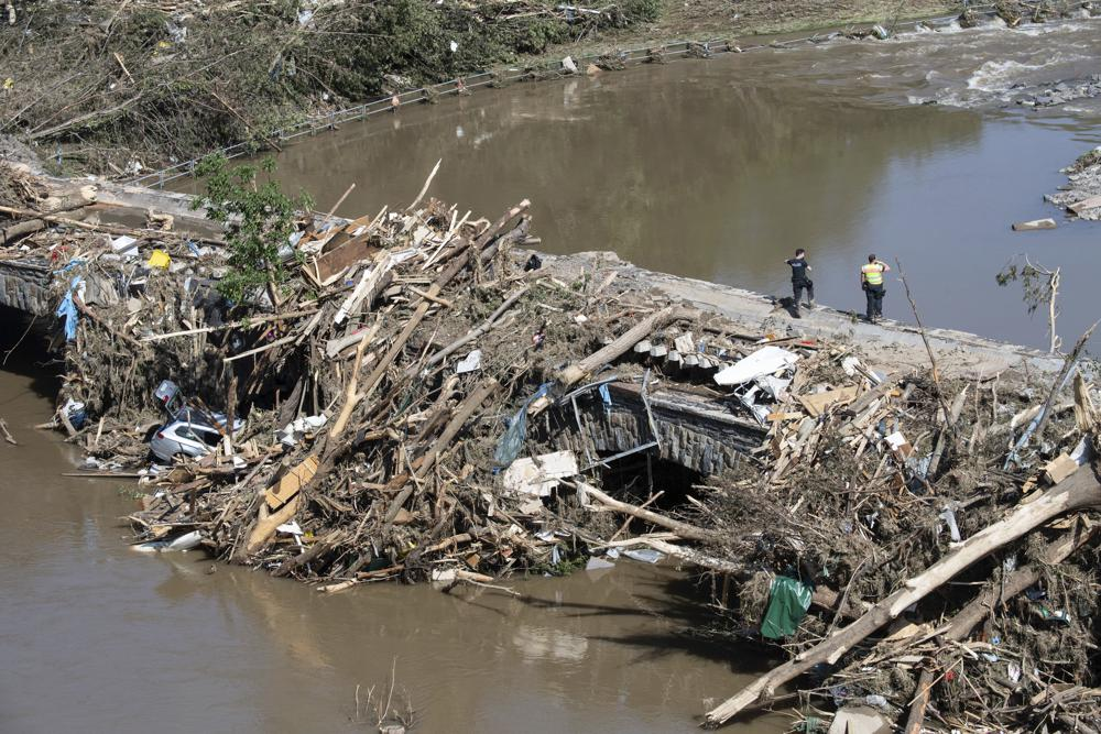 Police officers search in the rubble for possible victims, at a bridge over the River Ahr, in Altenahr, western Germany, Sunday, July 18, 2021. Photo: AP