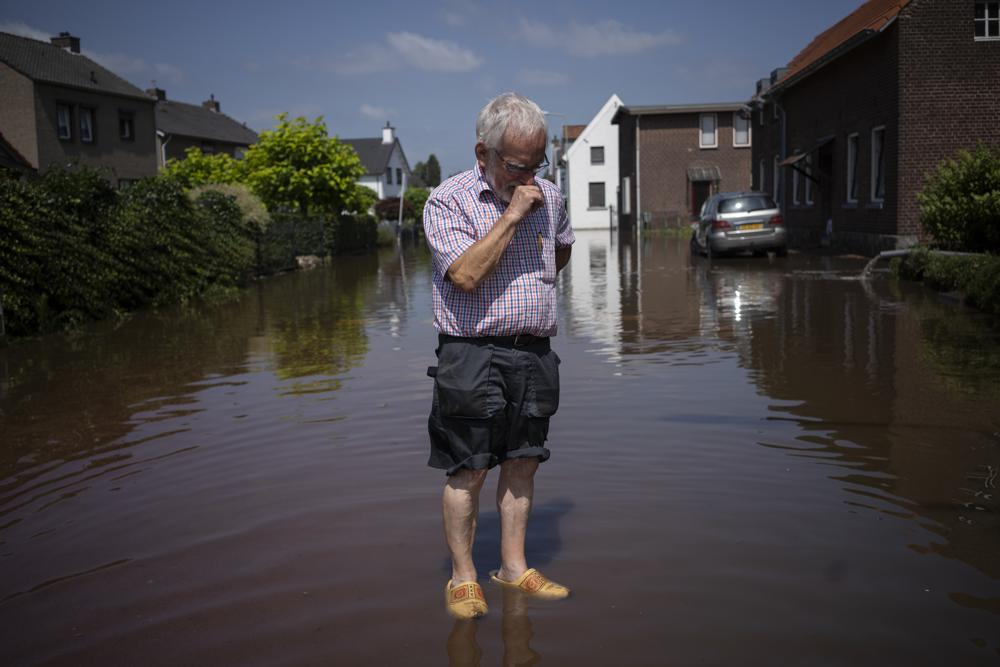 Wiel de Bie, 75, stands outside his flooded home in the town of Brommelen, Netherlands, Saturday, July 17, 2021. Photo: AP