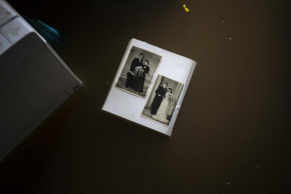 A view of wedding photos floating in water in a flooded basement of a home, in the town of Brommelen, Netherlands, Saturday, July 17, 2021. Photo: AP