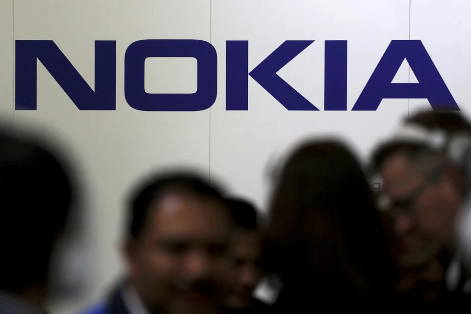 Visitors gather outside the Nokia booth at the Mobile World Congress in Barcelona, Spain, February 26, 2019. REUTERS/Sergio Perez/File Photo