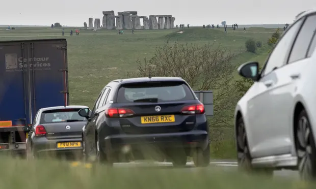 Traffic on the A303 that runs beside the ancient monument. Photograph: Matt Cardy/Getty Images