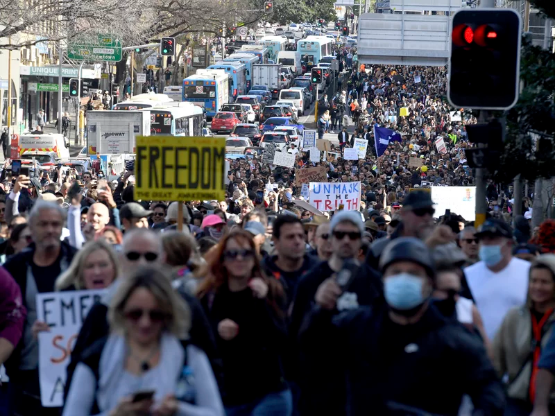 Protesters march through the streets in Sydney on Saturday. Mick Tsikas/AP