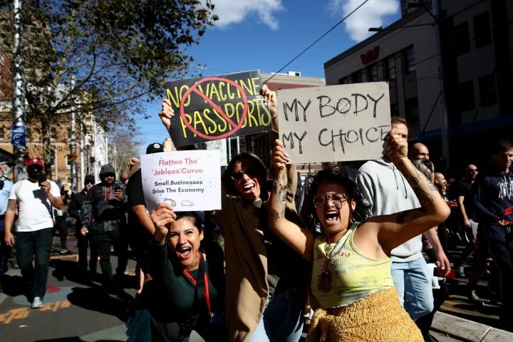 Protesters march down George St on July 24, 2021 in Sydney, Australia. Photo: Getty Images