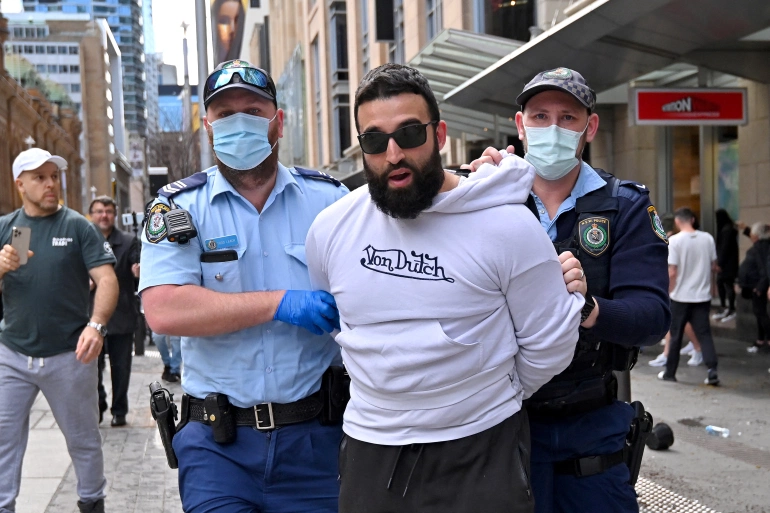 Police officers in Sydney detained several protesters [Steven Saphore/AFP]
