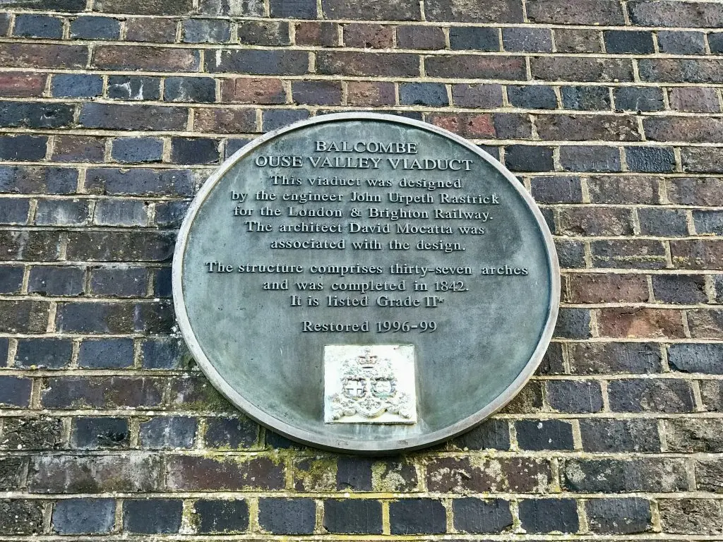Information about the Viaduct is given on a plaque on one of the brick piers supporting the bridge.  (Image: Martin Burton/SussexLive)