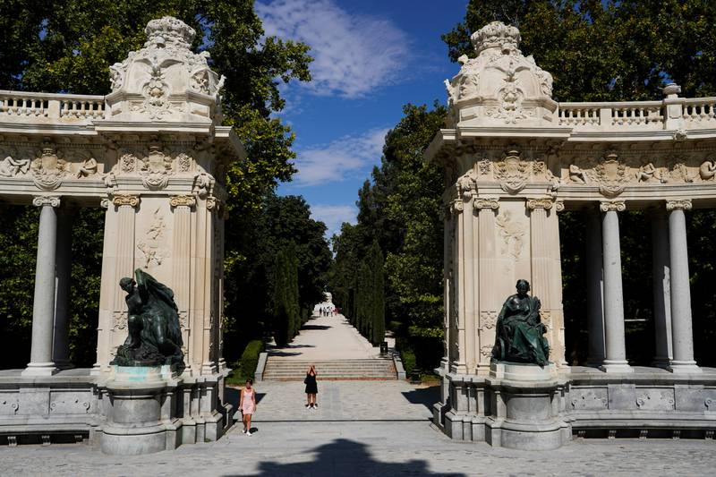 A woman takes pictures at El Retiro Park on the day that Unesco added Madrid's historic Paseo del Prado boulevard and Retiro Park to its list of World Heritage Sites (JUAN MEDINA/Reuters)