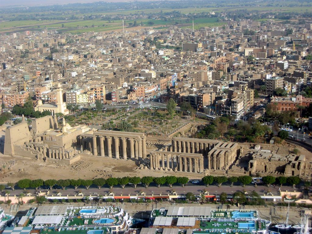 Ruins of ancient Luxor, surrounded by the modern-day city, Source: Pinterest