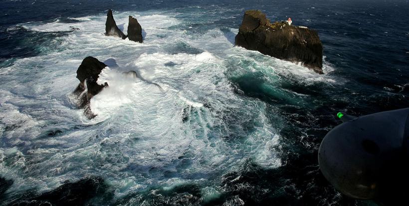 The strong surf below the lighthouse. Photograph/ Árni Sæberg