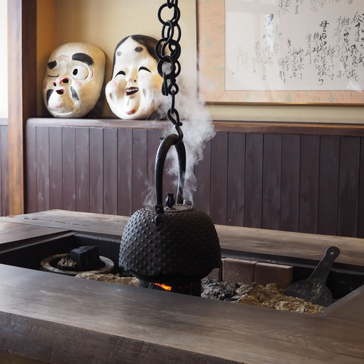 A fireplace at Kyounso Japanese Inn. The Onsen hot springs spa at Kyounso is available for both guests staying at the inn and visitors. Photo: Getty