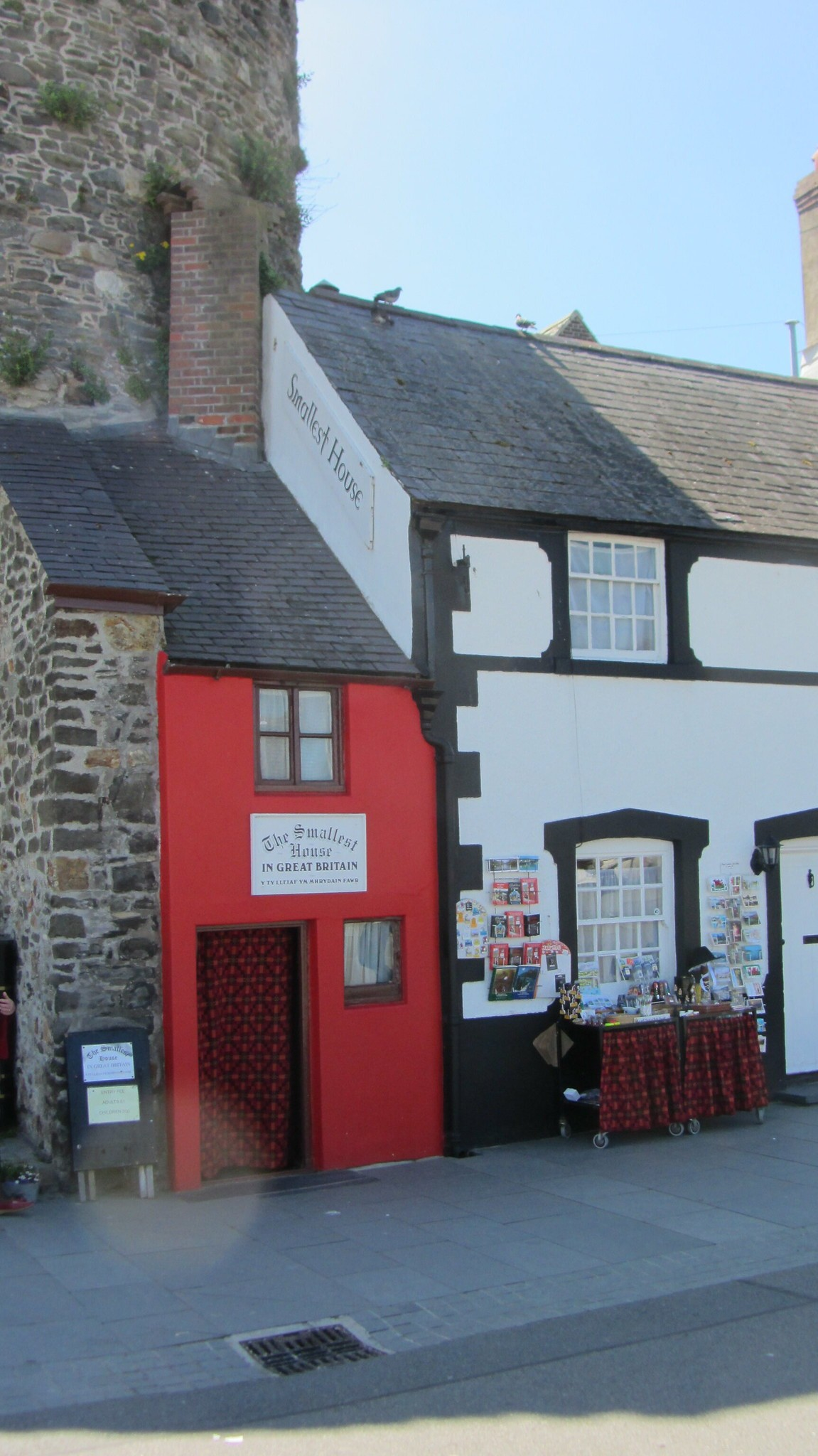 The petit red house becomes a highlight of the street. Photo: Unusual Places