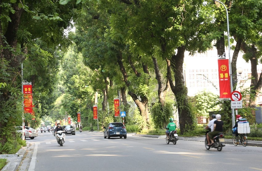 Red flag banners dot the lush green on Hoang Dieu Street in Ba Dinh District. Photo: VOV