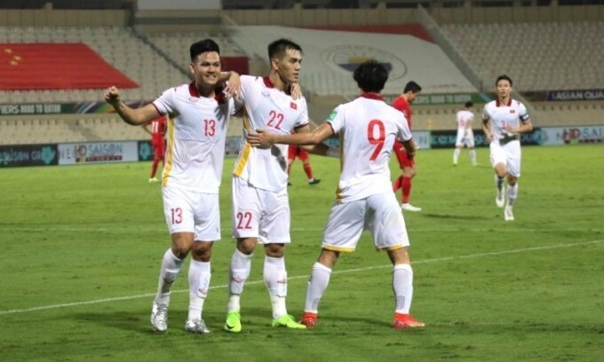 Ho Tan Tai (number 13) celebrates after scoring a goal in the World Cup qualifying clash between China and Vietnam on October 8, 2021. Photo: VnExpress