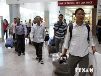 Amid tension, Vietnam suspends sending workers to Middle East