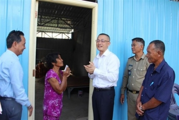 Three families of Vietnamese-Cambodians receive new houses after blaze last year