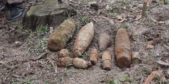 Project RENEW/NPA's team destroys explosive ordnance cache in Quang Tri
