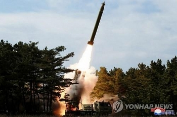 N.Korea fires 3 unidentified projectiles as S.Korea confirms more coronavirus cases