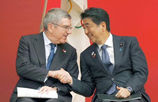 postpone tokyo olympics to hold next year