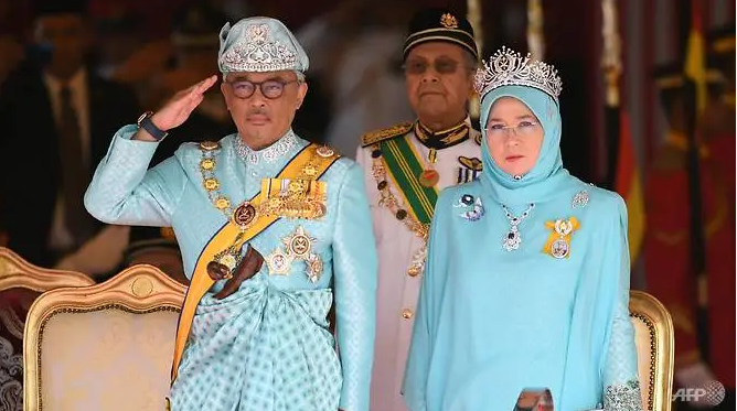 malaysias king and queen go into coronavirus quarantine after palace staff test positive
