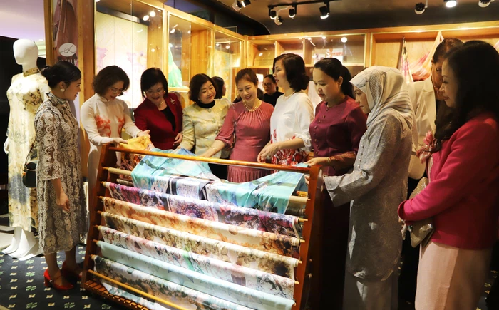 Female diplomats, representatives of international organisations, ambassadors' spouses gather