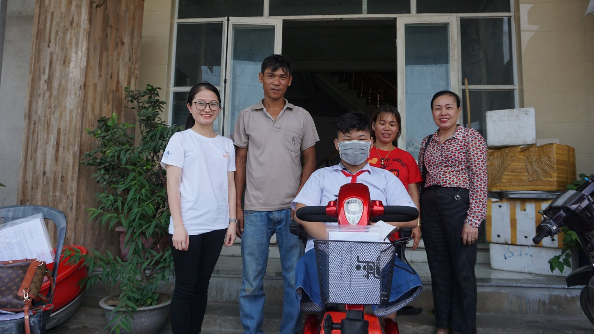 medipeace vietnam presents electric wheelchairs to children in quang tri