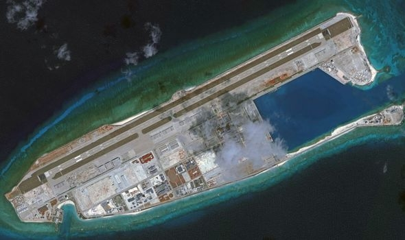 chinese aircraft landing at fiery cross reef vietnam urges parties not to further complicate situation