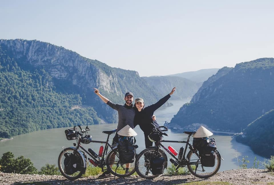 vietnamese french couple cycles from europe to asia for needy children