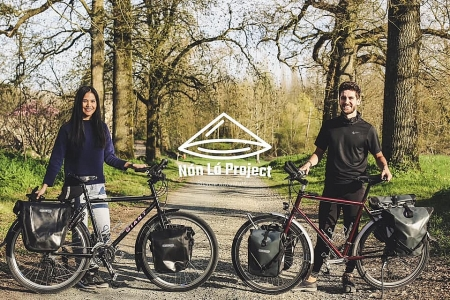 Vietnamese-French couple cycles from Europe to Asia for needy children