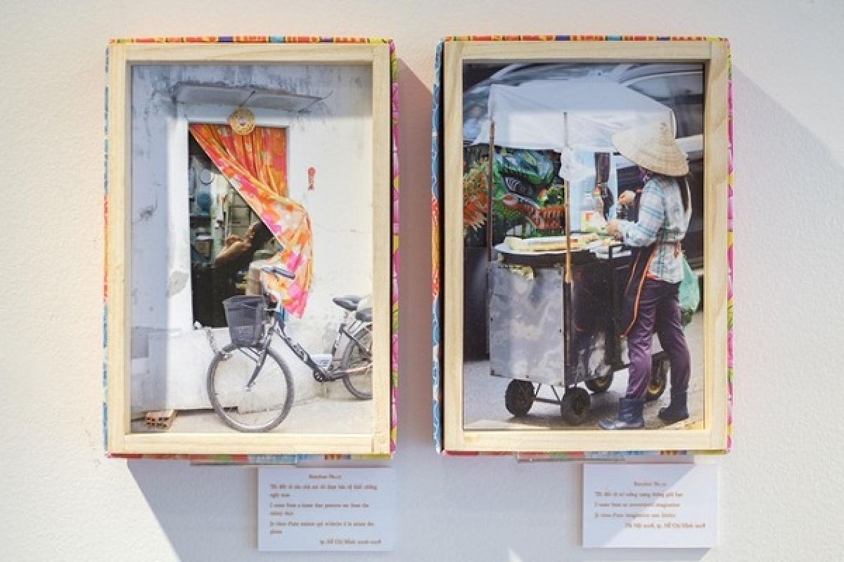 Bérengère Despax, who is also known as Bibi, and Nadège Simard have launched an exhibition in Hanoi with a range of special boxes showcasing the Vietnamese landscape and local people going about their daily lives. Photos: L'Espace