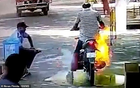Motorcycle catches fire while spraying disinfectant in India